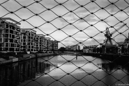 The Harbour of Offenbach behind a fence.